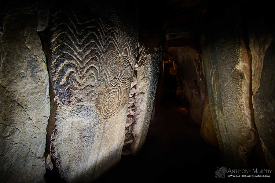 Orthostat stone L19 in the passage of Newgrange with its spirals and chevrons.